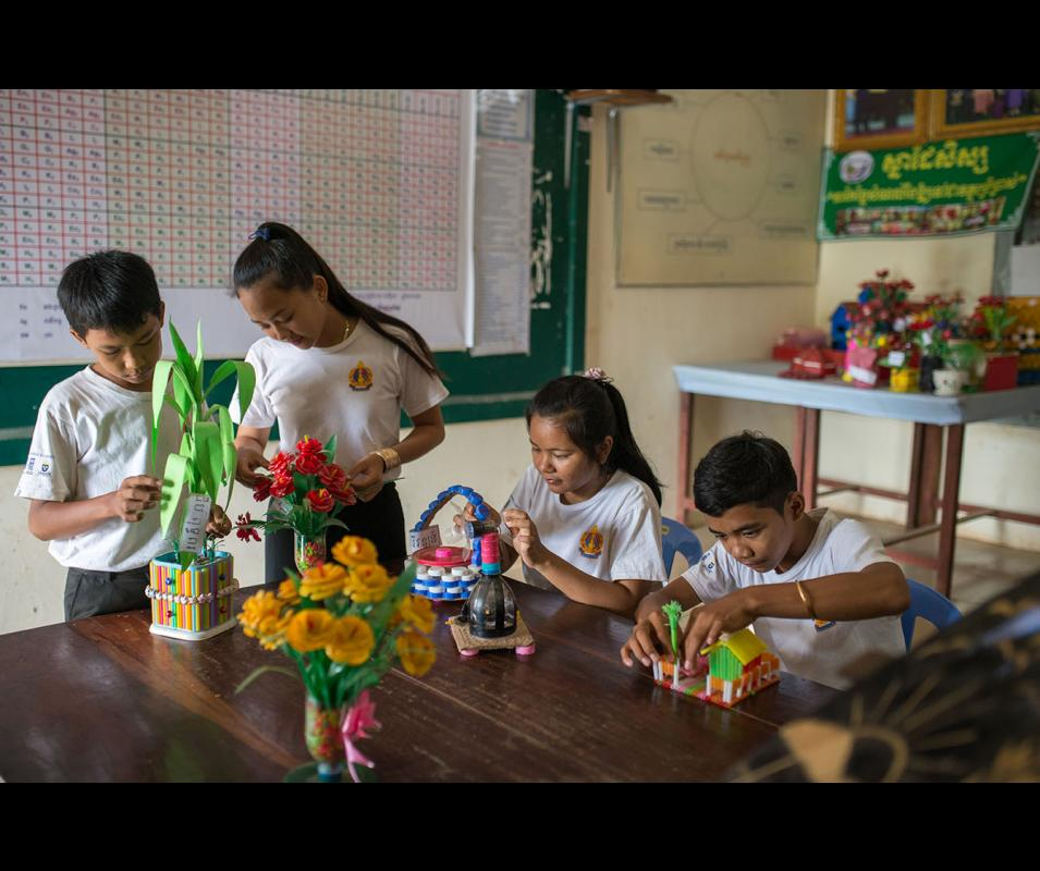 2018. One of key Eco-Schools activities is to minimize and eventually stop using plastic solid wastes in school. Through a competition event both sex students are transforming disposed plastic wastes such as bottles and straws into attractive souvenirs and reusable things. Chea Sim Angkor Chey Hight School Kampot Province Cambodia, @GCCA+, Kimlong Meng